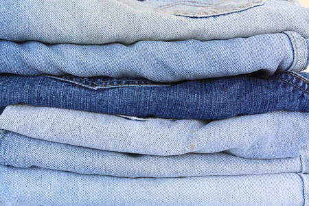 various shades of blue jeans on a white background  photo