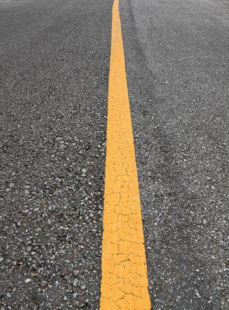 yellow lines on asphalt  photo
