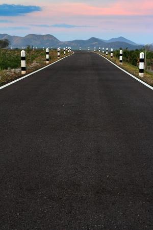 asphalt road at sunset