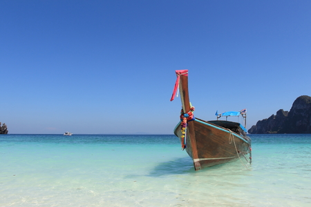 Long tail boat and tropical beach on Phi Phi island Thailand