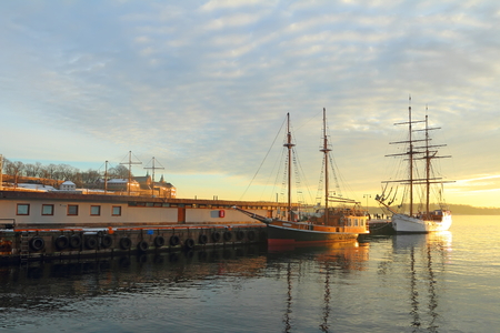 Old Town pier with old boats and sailing ship Stock Photo