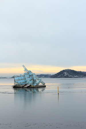 Oslo, Norway - December 30, 2018: She Lies, sculpture floating in the ocean water next to the Opera House of Oslo, Norway. Stock Photo - 117481652