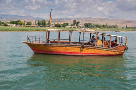 Wooden boats floating on the Sea of Galilee, Israel. Sunny day on Kinneret. High quality photo 写真素材