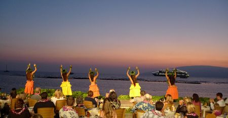 polynesian: Luau dancers at a dinner performance at a sun set Stock Photo