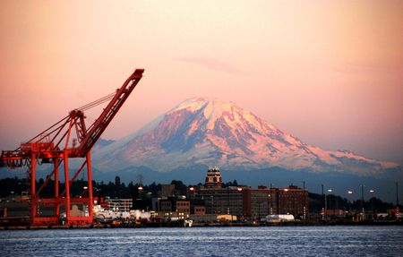 snow capped mountain: View of Mt. Rainier at sun set on a summer night