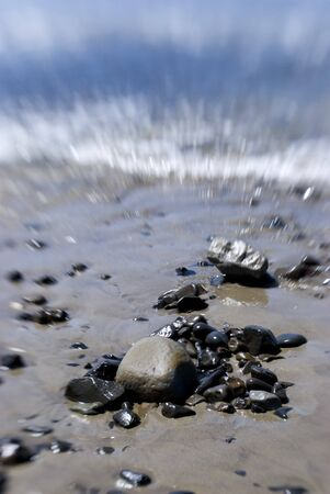 rocks on a beach in the the summer time