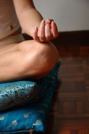 knees bent: Meditate Stock Photo