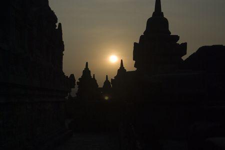pilgrim journey: The sun setting over Borobudur Temple