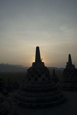 The sun setting over Borobudur Temple Stock Photo - 591349