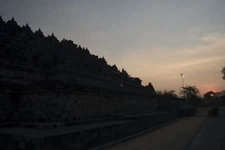 The sun setting over Borobudur Temple Stock Photo - 591353