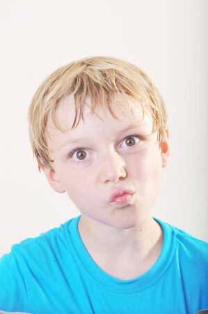 frown: Portrait of a young five year old boy