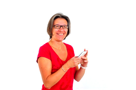 greying: A Woman in red t shirt on smartphone in studio