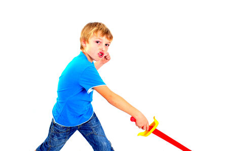A young boy playing with sword on a white background photo