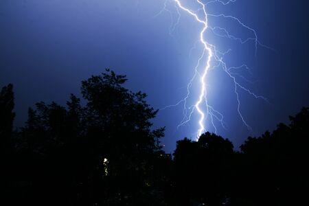 Thunder on the night sky background