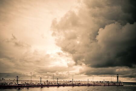 Pier in Poland before the storm,  sepia version