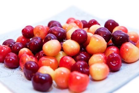 Plate full of sweet cherries