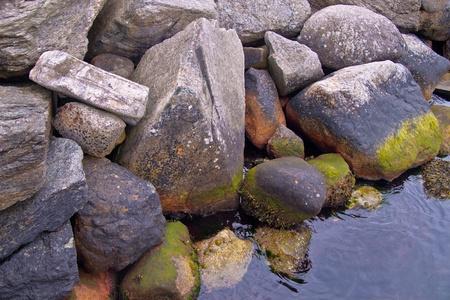 Shore made of rocks in Norwegian fjord