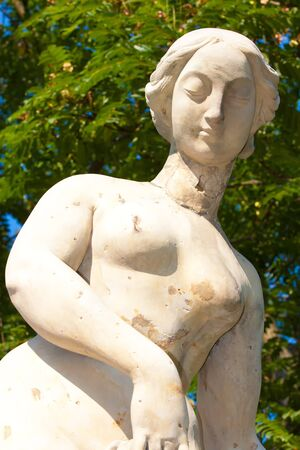 Burst of naked lady sculpture in the park