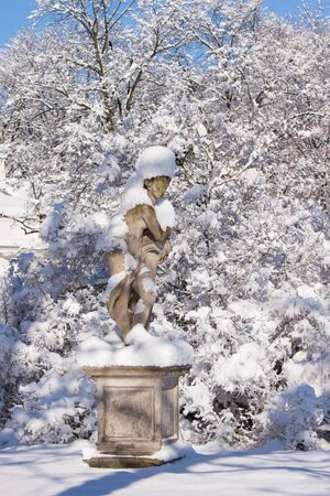 Naked lady statue covered in snow in Warsaw Lazienki park, after heavy snow fall, Poland Stock Photo