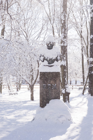 Bem statue covered in snow in Warsaw park Lazienki during winter, Poland