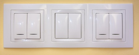 White light switches applied on  yellow wall