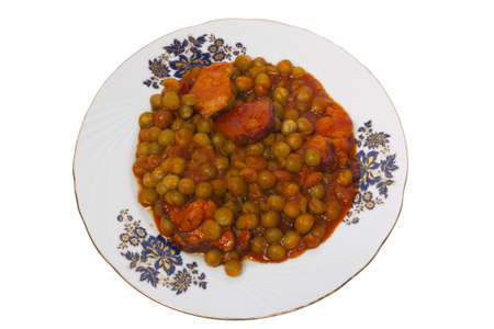 Cooked peas with bacon and carrots photo