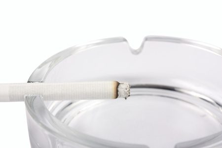 Ashtray with cigarette close-up isolated on white background