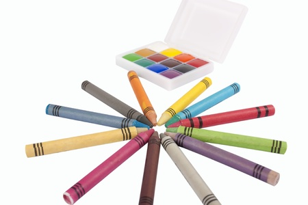 Colored wax pencils and a watercolor isolated on a on white background  photo