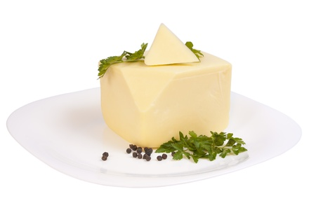 peppar: Cheddar cheese with parsley and pepper on a plate isolated over white background