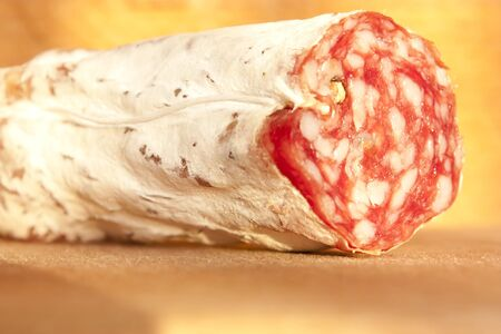 trencher: Closeup of italian typical salami on wood trencher