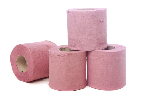 Pink toilet paper isolated over white background photo