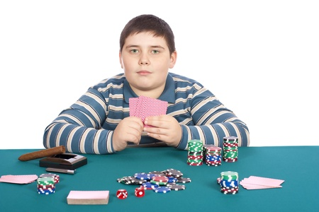 Child playing poker at green table with white background photo