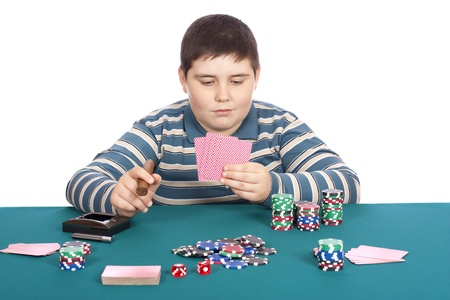 Child playbg poker at green table with white background