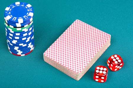 Cards, chips and dices for playing poker on the pokertable photo