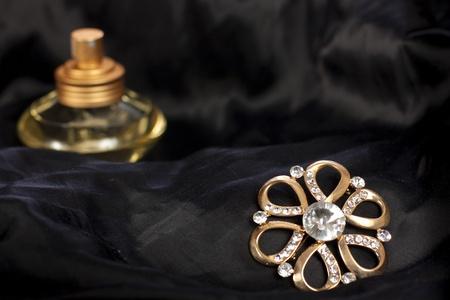 brilliants: Elegant jewelry with brilliants and perfume on black silk