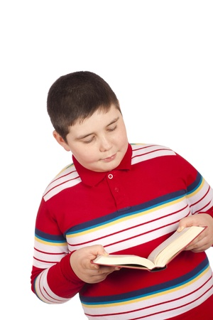 Eight year old boy reading isolated over white background photo