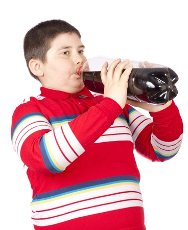 frisdrank: A young men drinking soda from a plastic bottle isolated over white background