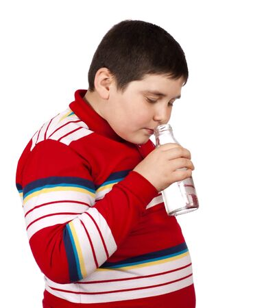 Child smelling a bottle of water isolated over white background Stock Photo