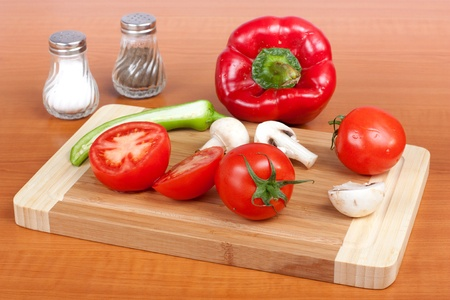Fresh vegetables for all seasons on cutting board in kitchen  photo