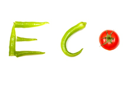 Vegetable selection spelling the words ECO, isolated over white background photo
