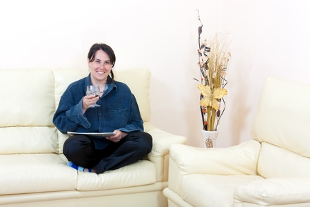 Living room interior in luxurious newly built home and a woman who reads the paper photo