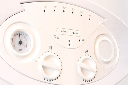 The controls on a domestic central heating and hot water combination boiler