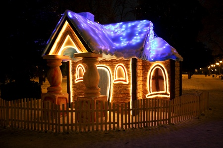 doll house: One little house lit at night in winter Stock Photo