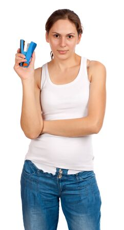 Beautiful smiling woman with a blue stapler in one hand, isolated over white background