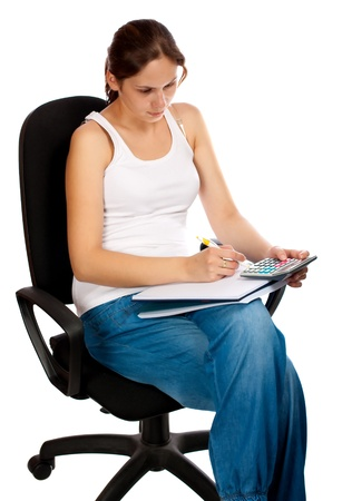 Woman with calculator, sitting on chair, isolated over white background