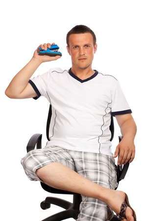 Man sitting on office chair with a stapler in hand, isolated over white background photo