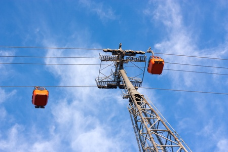 High Cable car working against blue sky  Stock Photo