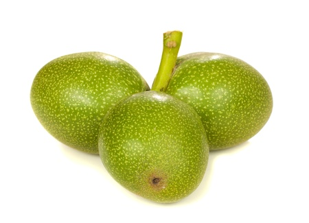 Three raw walnut isolated over white background