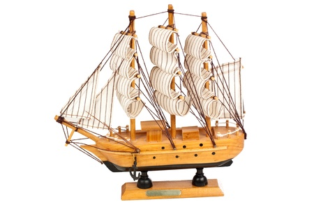 Miniature wooden model of a ship isolated on white background Stock Photo - 10661136
