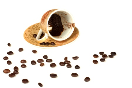 Empty cups of mocha and some coffee beans over white background  photo